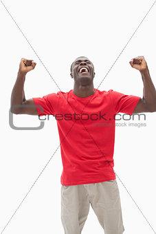 Football fan in red cheering