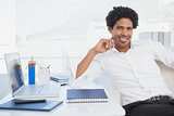 Happy businessman working at his desk