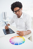 Hipster designer working at his desk