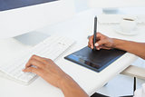Designer working at desk using digitizer