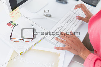 Casual businesswoman working at her desk
