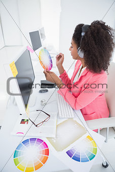 Casual graphic designer working at her desk