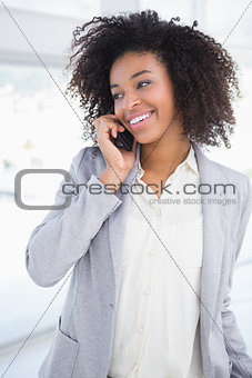 Casual businesswoman talking on phone