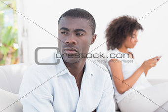 Attractive couple having an argument on couch