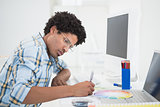 Young designer working at his desk