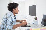 Young designer working at his desk with digitizer