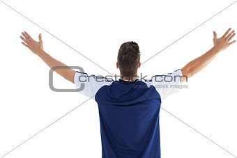 Football player in blue celebrating a victory