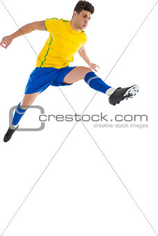 Football player in yellow jumping