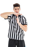 Stern referee showing time out sign