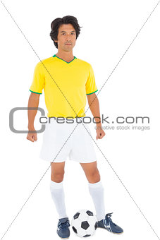 Football player in yellow with ball