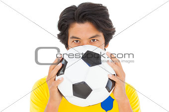 Football player in yellow holding ball