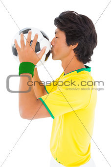 Football player in yellow kissing ball