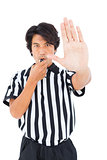 Stern referee showing stop sign with hand