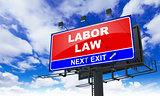 Labor Law on Red Billboard.