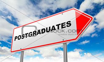 Postgraduates on Red Road Sign.