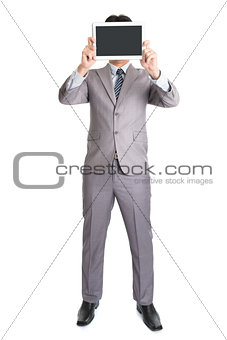 Asian businessman using computer tablet covering his face