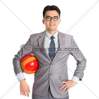 Asian businessman with soccer ball