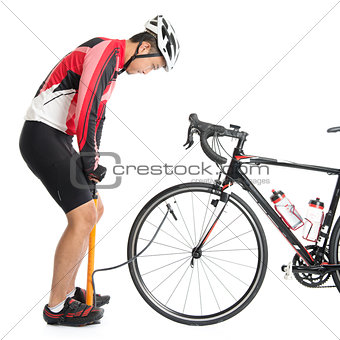 Asian cyclist using air-pump