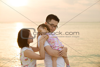 Asian family vacation at beach
