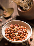 rustic raw uncooked peanuts