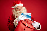 Santa with airline tickets
