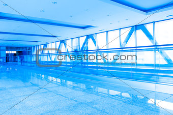 corridor structure with glass walls in blue
