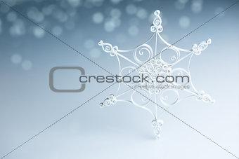 Beautiful white handmade quilling snowflake on blue - horizontal
