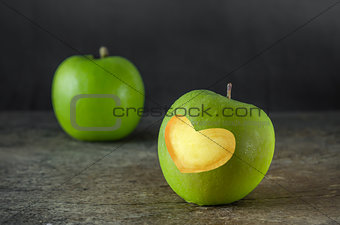 green apple with heart shape