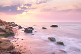 Sunrise landscape over beautiful rocky coastline in the Sea