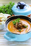 vegetable pumpkin cream soup with walnuts and parsley