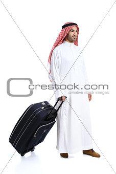 Arab traveler saudi man carrying a suitcase