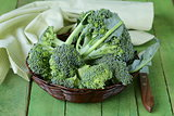 fresh organic broccoli in a wicker basket