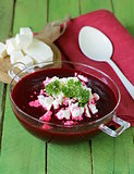 vegetable cream soup of beetroot with soft goat cheese