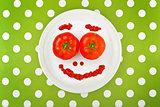 Ripe tomato as smiley emoticon