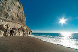 Beautiful sunny day landscape,blue sea and old wall