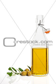 Olive oil isolated on white.