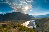 bright sun above the valley of the river Katun, Altai