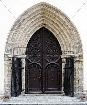 Ancient wooden door design in old city in Tallinn, Estonia
