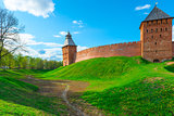 green lawn and a moat around the walls of the Novgorod Kremlin