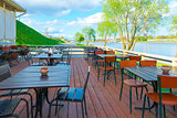 urban riverfront cafes and green trees