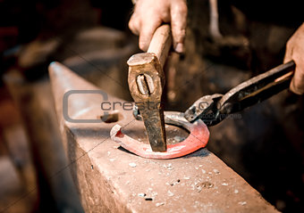 Blacksmith make a horseshoe