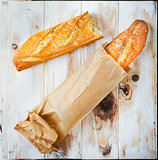 Baguette in a grocey paper bag. Loaf of bread