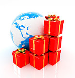 Traditional Christmas gifts and earth on a white background. Glo