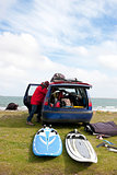 windsurfer getting ready from his car