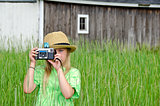 girl with old-fashioned camera