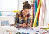 Tailor woman working in studio