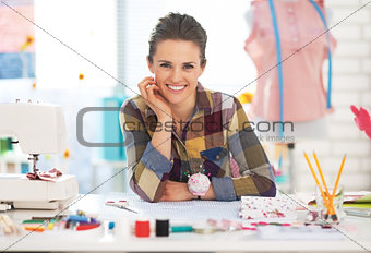 Portrait of happy dressmaker woman in studio