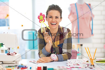 Portrait of smiling dressmaker woman in studio