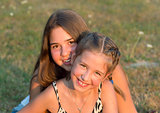 Outdoor portrait of two girls.