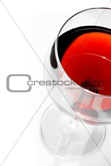 top of view of half red wine glass with space for text under daily light